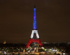 The_Eiffel_Tower_lit_up_in_French_colours_after_the_November_2015_Paris_attacks