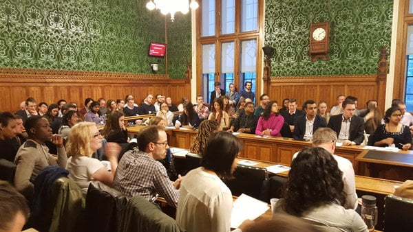 Young people discuss the free market in parliament