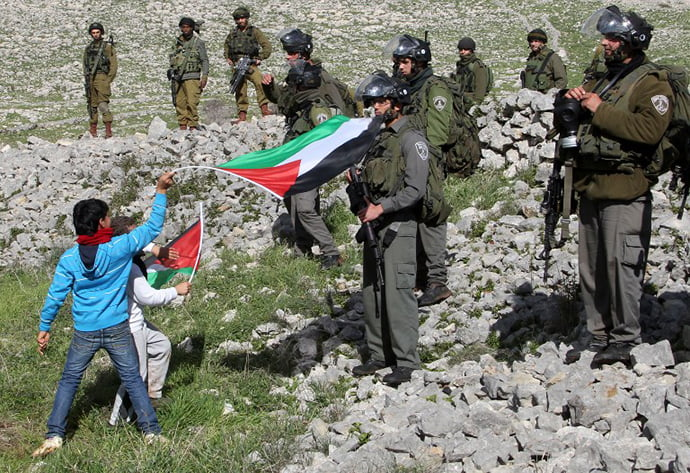 Palestinians kids and Israel soldiers facing off