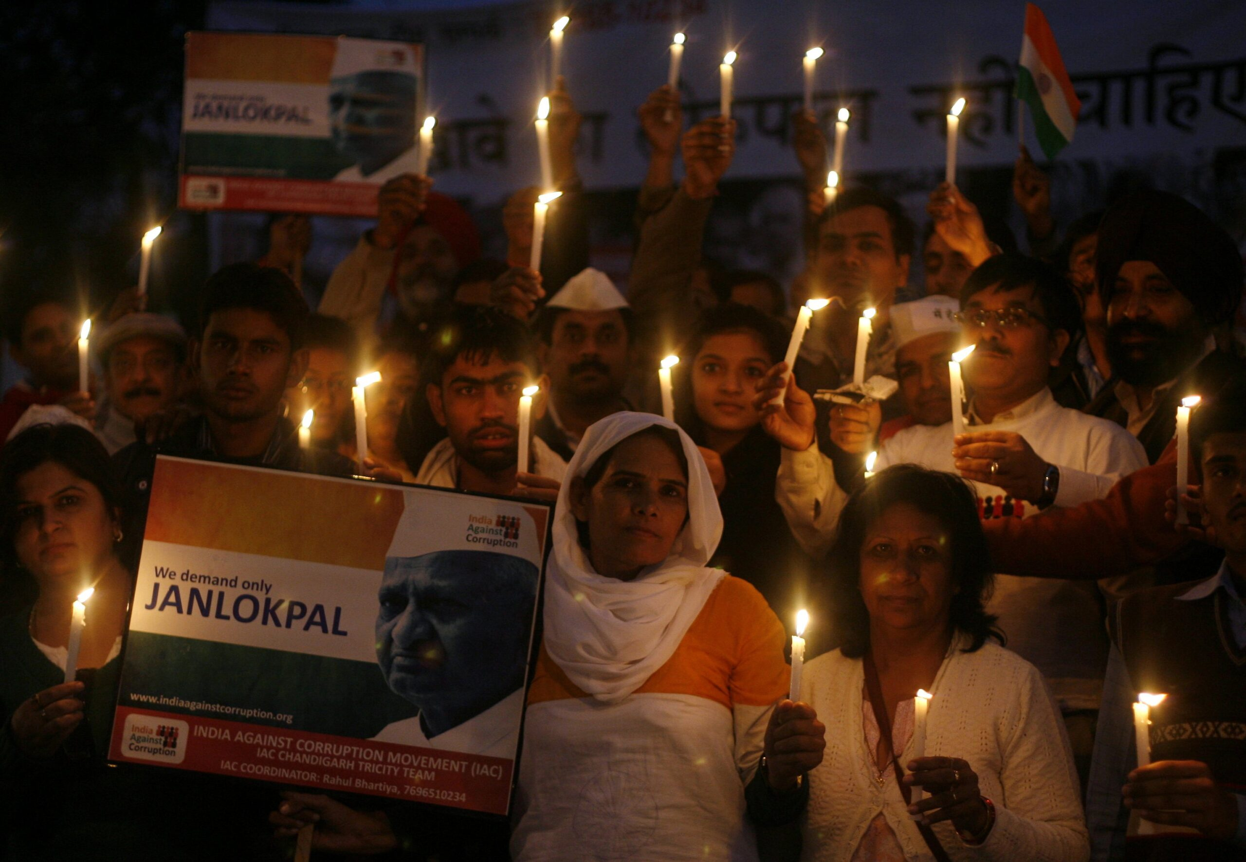 Supporters of veteran Indian social activist Anna Hazare take part in a candlelight protest against the ruling government in Chandigarh