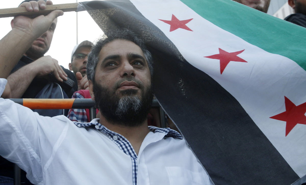 Lebanese singer Fadel Shaker waves a Syrian opposition flag as he takes part in a protest organized by Sunni Muslim Salafist leader Ahmad al-Assir, against the Syrian regime in Sidon, southern Lebanon