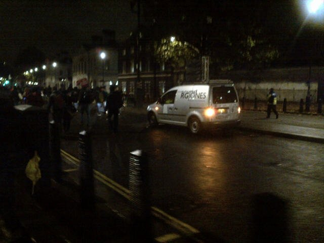 Police vehicle follows protesters while reading out warnings