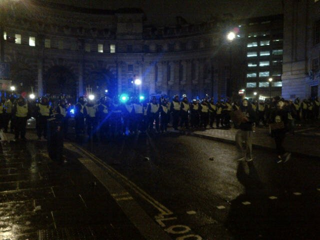 Police prepare to kettle final protesters returning to Trafalgar Square