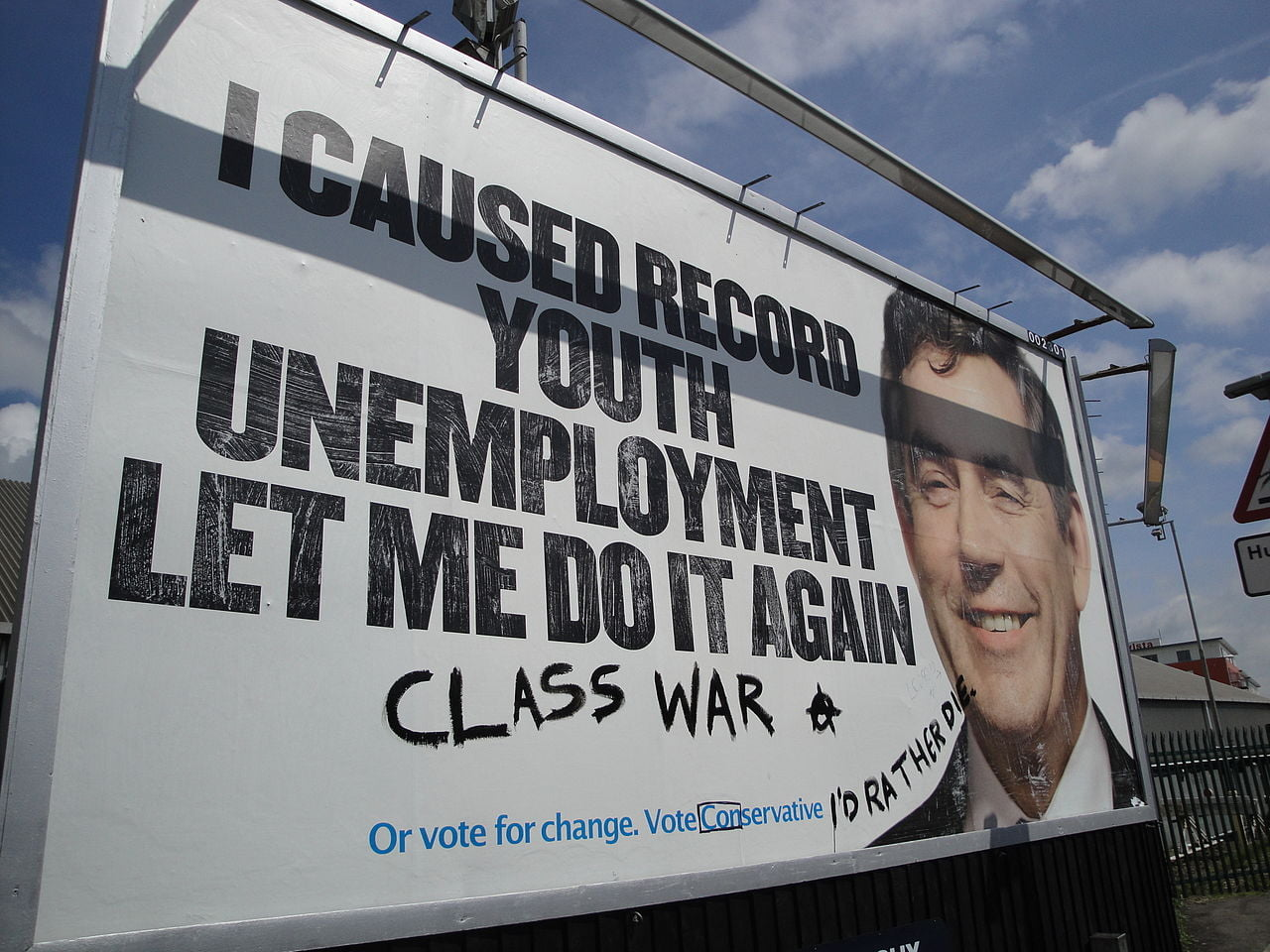 defaced tory poster
