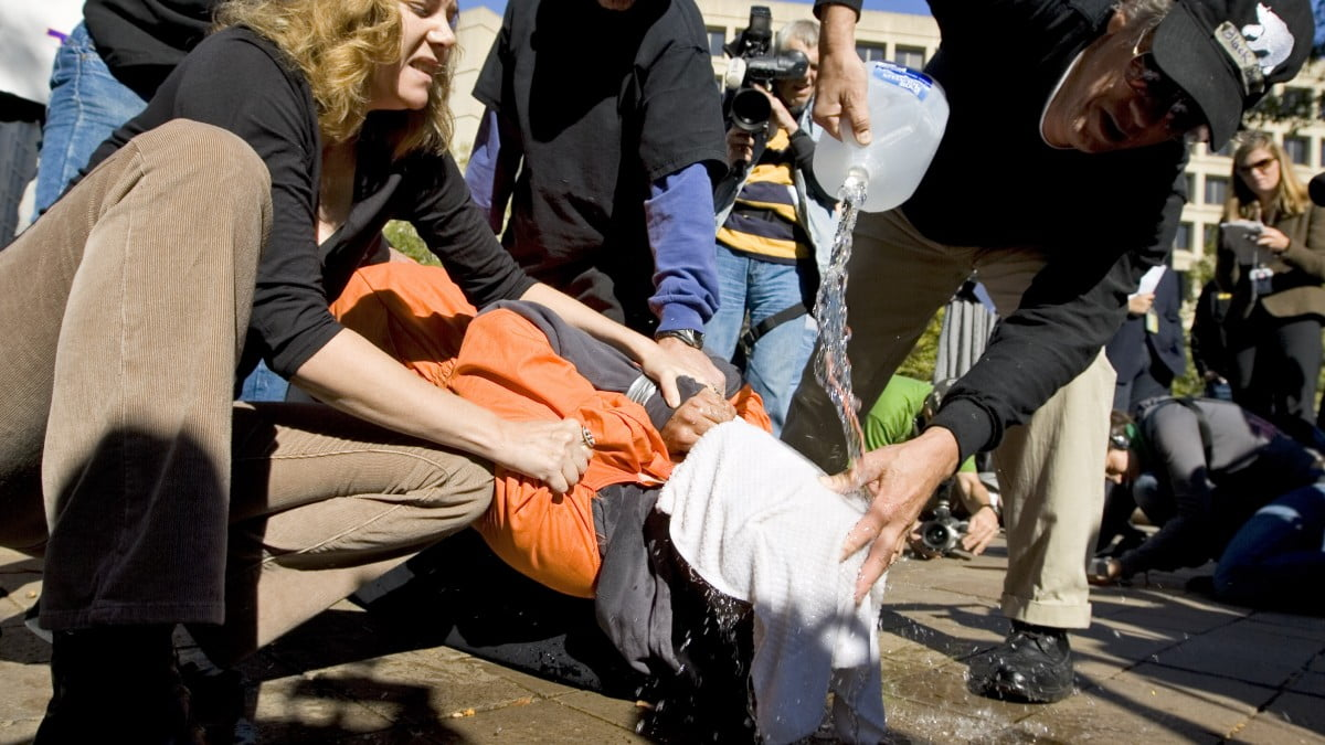 Protestors demonstrate the use of water boarding to volunteer Maboud Ebrahim Zadeh, Monday, Nov. 5, 2007, in front of the Justice Department in Washington. (AP Photo/Manuel Balce Ceneta)